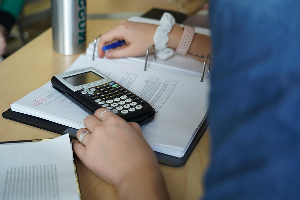 A student works on a calculator during class