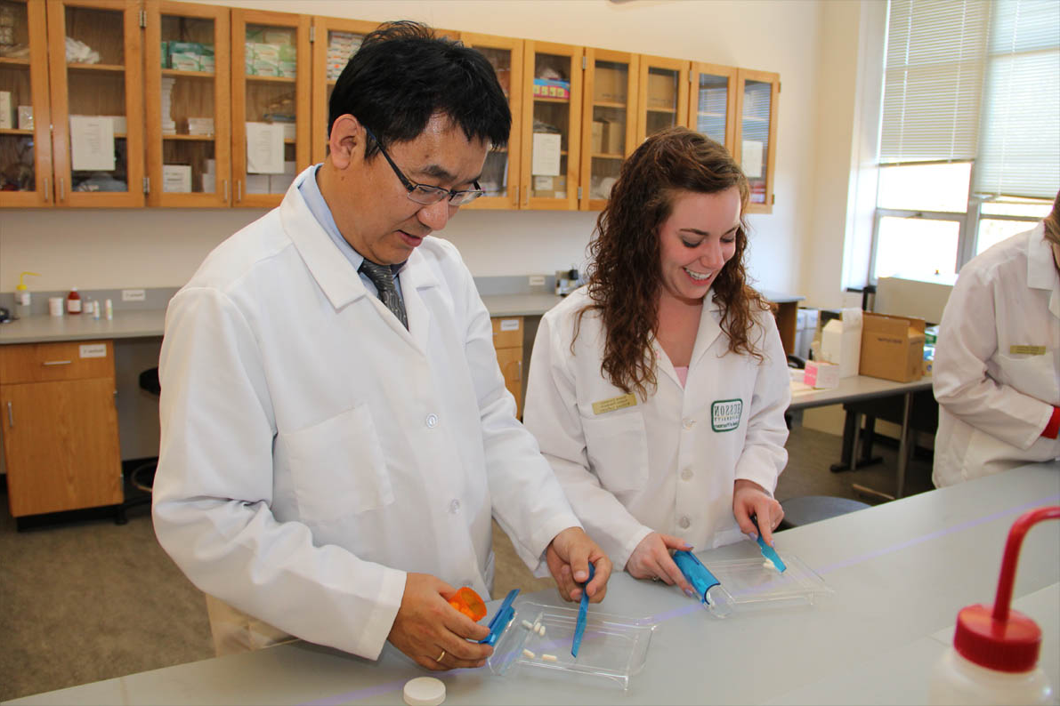 Students and faculty work in the compounding lab